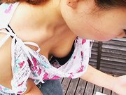 Skinny Asian girl gives a downblouse peek in the spy cam