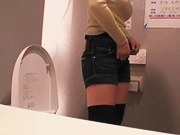 Busty delightful Jap screwed after taking a good piss