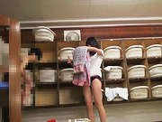 Asian girl in changing room shows her thick hairy cunt pk01