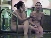 Asian women wash and sit talking in shower voyeur cam vid dvd 03056